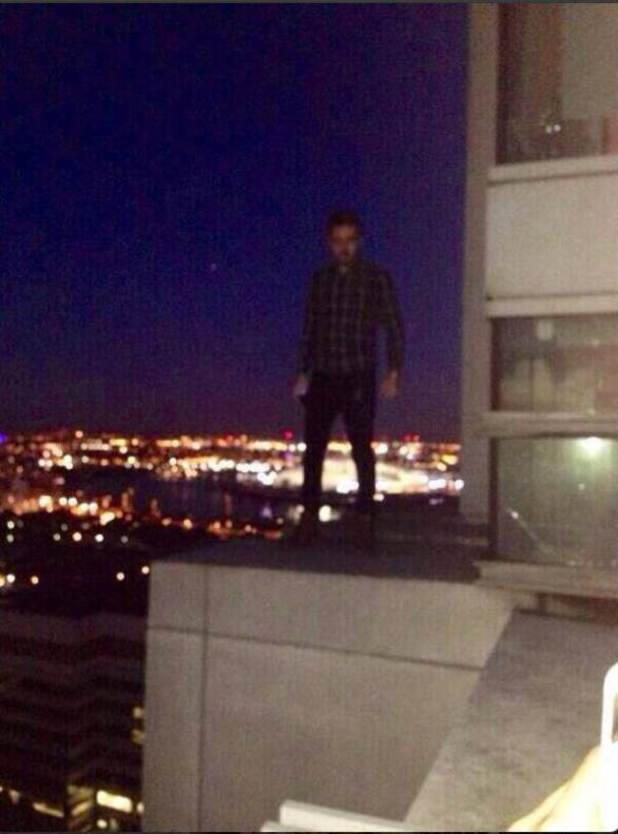 Liam Payne standing on a balcony