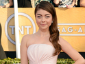 A man is arrested after allegedly groping Sarah Hyland while she poses for a photo.