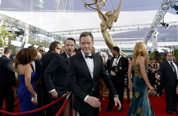 LOS ANGELES, CA - SEPTEMBER 22: Actors Aaron Paul (L) and Bryan Cranston arrive at the 65th Annual Primetime Emmy Awards held at Nokia Theatre L.A. Live on September 22, 2013 in Los Angeles, California. (Photo by Kevork Djansezian/Getty Images)