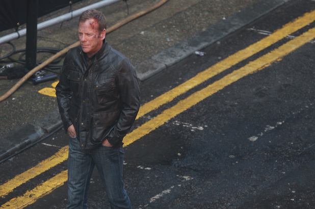 Kiefer Sutherland on the set of hit U.S. television thriller '24'. In one particular scene, Kiefer carries a handgun and a London taxi explodes in a busy street.