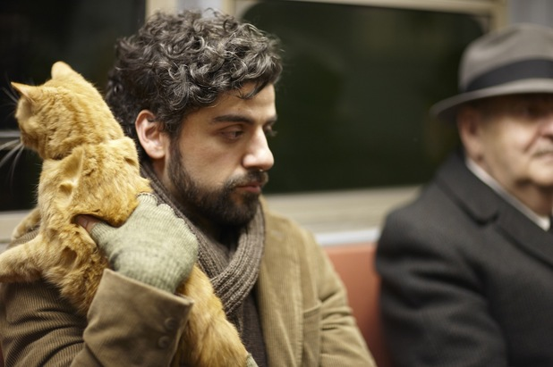 Oscar Isaac as Llewyn Davis with Ulysses the cat