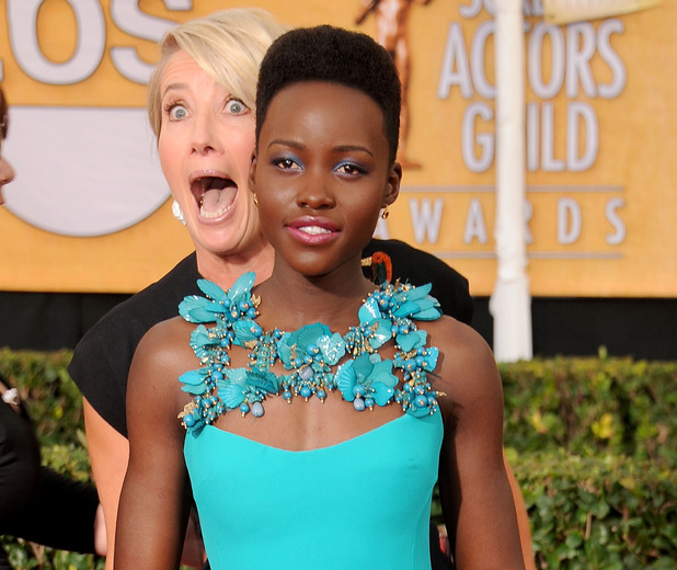LOS ANGELES, CA - JANUARY 18: Actors Emma Thompson and Lupita Nyong'o arrive at the 20th Annual Screen Actors Guild Awards at The Shrine Auditorium on January 18, 2014 in Los Angeles, California. (Photo by Gregg DeGuire/WireImage)