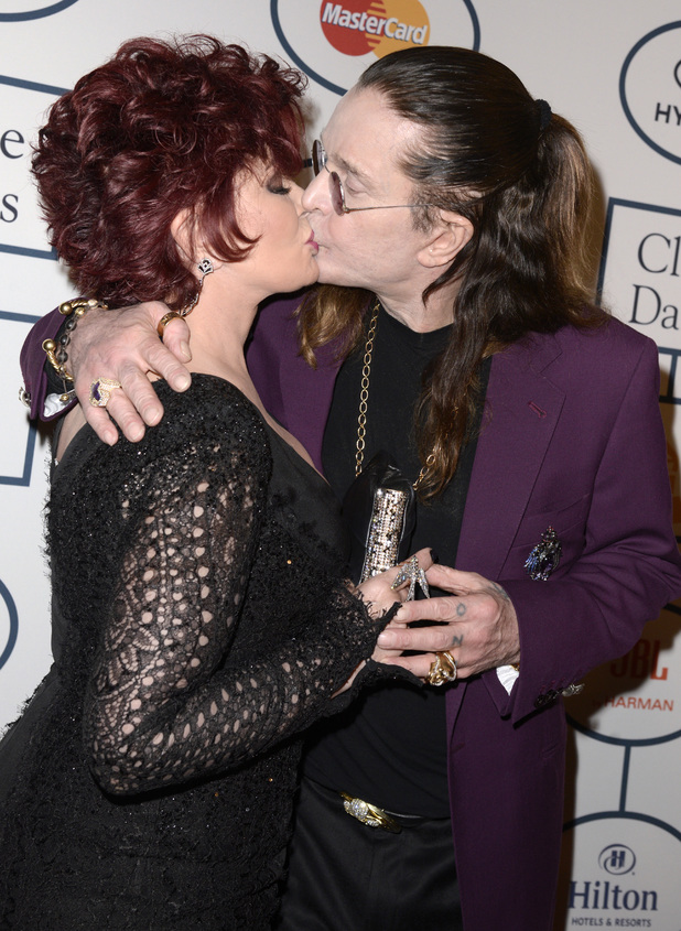 Sharon Osbourne and Ozzy Osbourne kiss at the 56th annual GRAMMY awards - salute to industry icons with Clive Davis,