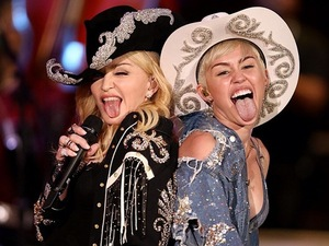 Madonna and Miley Cyrus perform at MTV Unplugged.