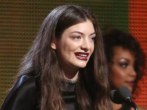 "Lorde accepts the award for best pop solo performance for ""Royals"" at the 56th annual Grammy Awards"