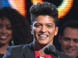 "Bruno Mars accepts the award for best pop vocal album for ""Unorthodox Jukebox"" at the 56th annual Grammy Awards"