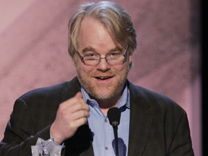 "Philip Seymour Hoffman accepts the award for best actor, for his work in the film ""Capote,"" at the 11th Annual Critics' Choice Awards in Santa Monica, Calif., Monday, Jan. 9, 2006. (AP Photo/Kevork Djansezian)"