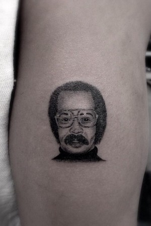 Drake's dad tattoo