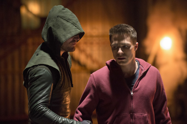 Stephen Amell as The Arrow and Colton Haynes as Roy Harper in 'Arrow' S02E12: 'Tremors'