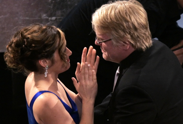 Philip Seymour Hoffman is congratulated by girlfriend Mimi O'Donnell after winning the Oscar for best actor for his work in