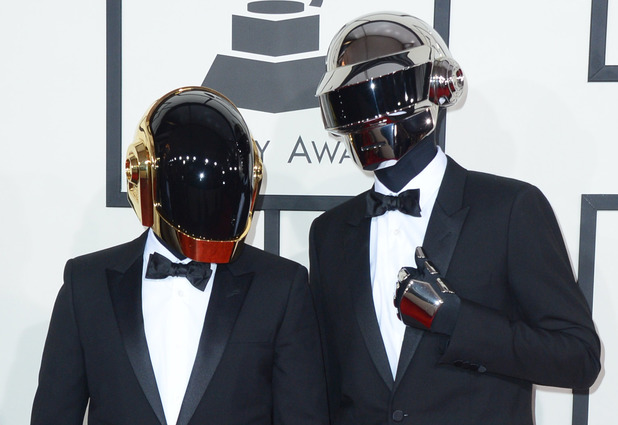Daft Punk arriving at the 56th annual Grammy Awards