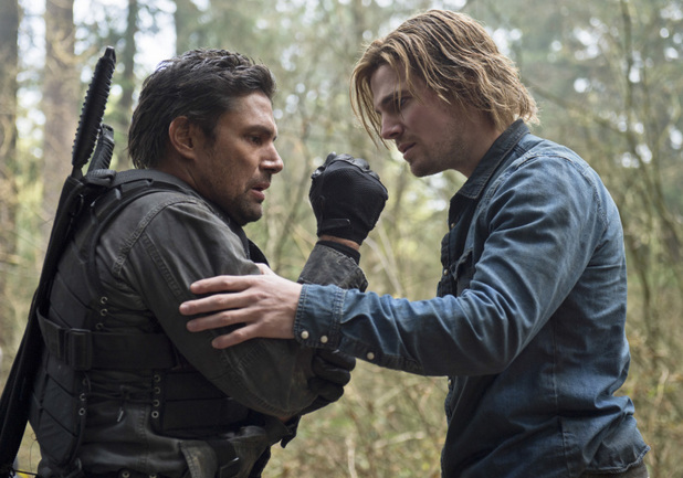 Manu Bennett as Slade Wilson and Stephen Amell as Oliver Queen in 'Arrow' S02E12: 'Tremors'