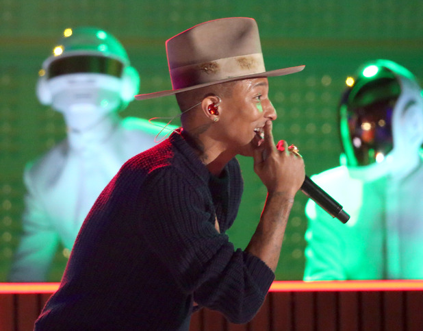 Pharrell Williams performs with Thomas Bangalter, background left, and Guy-Manuel de Homem-Christo of Daft Punk, at the 56th annual Grammy Awards