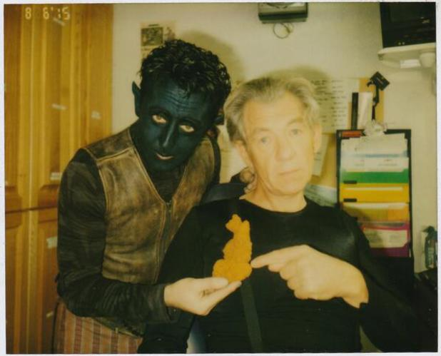 Alan Cumming and Ian McKellan pose with British Isles-shaped cookie on X-Men 2 set