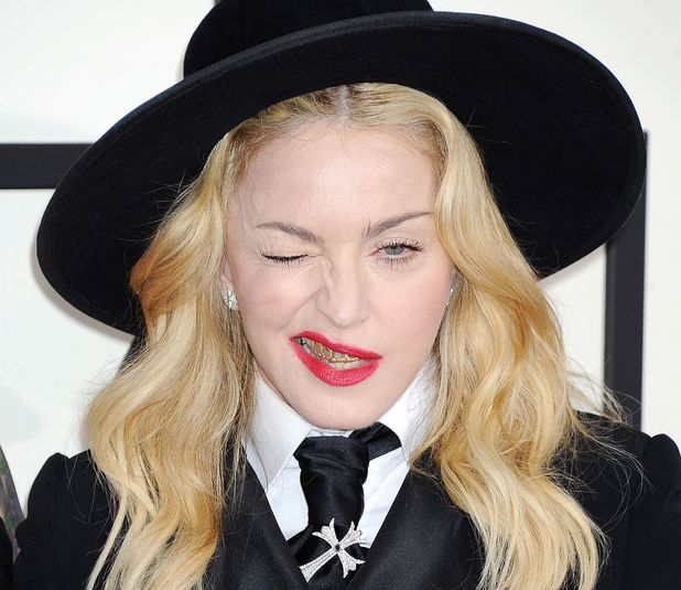 Madonna shows her grill at the Grammys