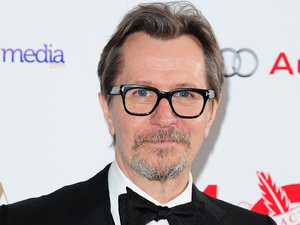 Gary Oldman wins the Dilys Powell Award for Excellence in Film at the 2014 London Critics' Circle Awards, at the May Fair Hotel, Stratton Street, London. Picture date: Sunday February 2, 2014. See PA story SHOWBIZ Critics. Photo credit should read: Ian West/PA Wire