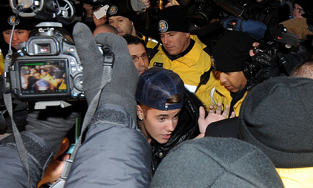 Justin Bieber appears at a police station in connection with an alleged criminal assault on January 29, 2014 in Toronto, Canada.