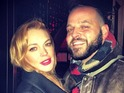 Daniel Franzese (Damian) poses with Lohan ahead of the film's ten-year anniversary.