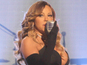 Mariah Carey signs deal with Epic Records