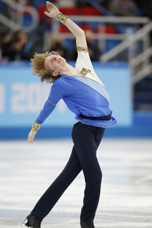 Sochi 2014 Winter Olympic Games, Russia - 13 Feb 2014 Kevin Reynolds performs during the men's short program figure skating 13 Feb 2014