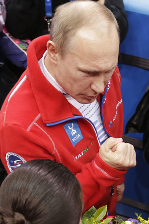 Russian President Vladimir Putin, left, speaks with Julia Lipnitskaia of Russia after Russia placed first in the team figure skating competition at the Iceberg Skating Palace during the 2014 Winter Olympics, Sunday, Feb. 9, 2014, in Sochi, Russia