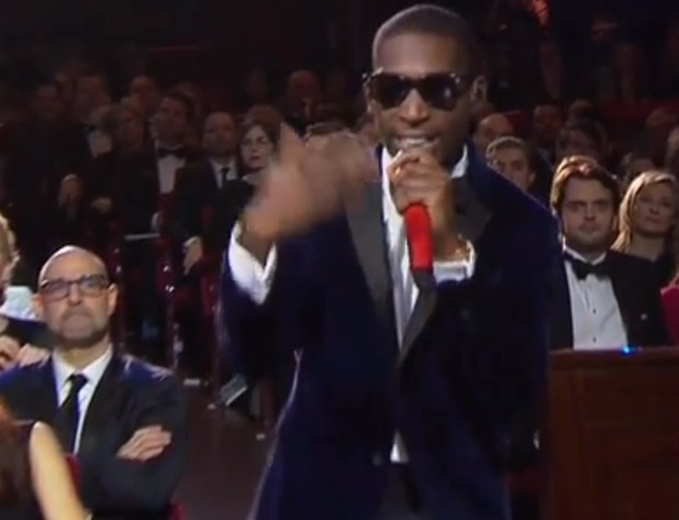 Stanley Tucci watches Tinie Tempah at the BAFTAs
