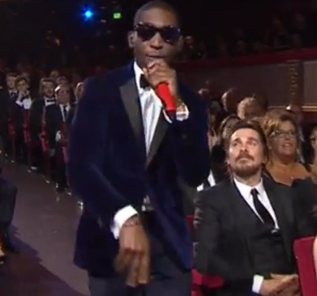 Christian Bale watches Tinie Tempah at the BAFTAs