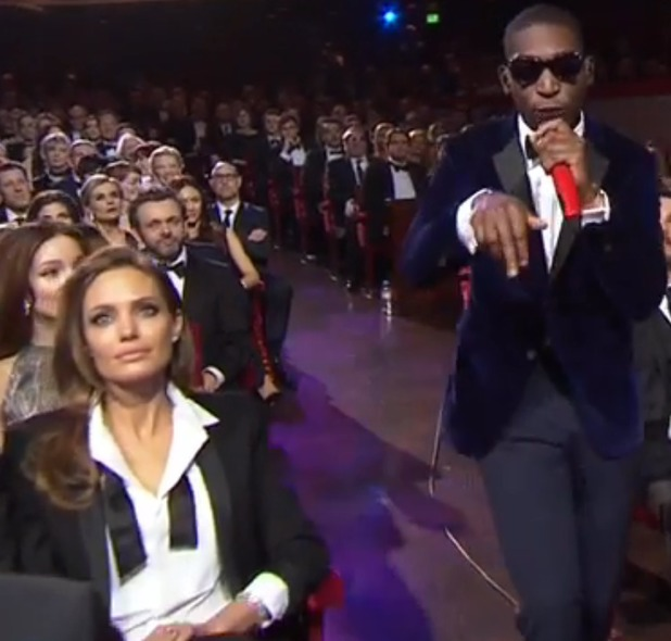 Angelina Jolie watches Tinie Tempah at the BAFTAs