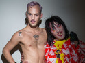 Mighty Boosh star wears flamboyant creations at Bas Koster's runway show.