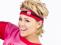 Girls Aloud star dons a headband and turns her hair into a mullet for a new shoot.