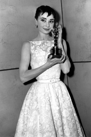 "Oscar-winner Audrey Hepburn poses with her statuette at the 26th Annual Academy Awards ceremony in New York on Hepburn won for best actress for her portrayal in ""Roman Holiday."" March 25th, 1954. (AP Photo)"
