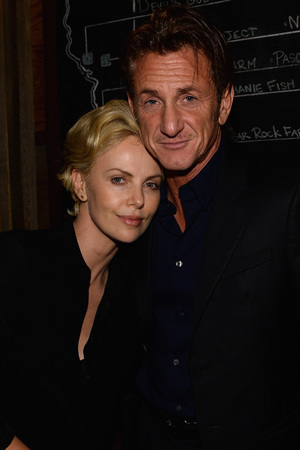LOS ANGELES, CA - FEBRUARY 27: Charlize Theron and Sean Penn attend Bionic Yarn, G-Star and Hennessy Privilege Celebrate Pharrell Williams and his Oscar nominated single, 'Happy' on February 27, 2014 in Los Angeles, California.