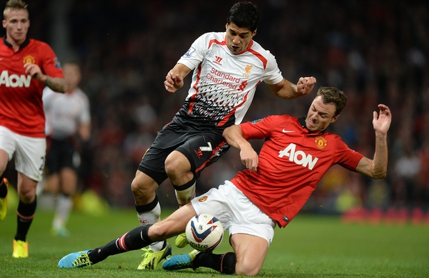 Liverpool's Luis Suarez  and Manchester United's Jonny Evans