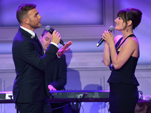 Gary Barlow and Laura Michelle Kelly perform onstage at The Weinstein Company's Academy Award