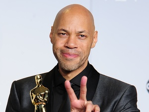 John Ridley in the press room with hs award for Best Adapted Screenplay received for '12 Years a Slave'