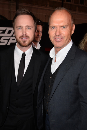 HOLLYWOOD, CA - MARCH 06: Actors Aaron Paul (L) and  arrive at the premiere of DreamWorks Pictures' 'Need For Speed' at TCL Chinese Theatre on March 6, 2014 in Hollywood, California. (Photo by Kevin Winter/Getty Images) Michael Keaton