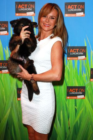 Crufts Dog Show, NEC Birmingham, Britain - 07 Mar 2014 Amanda Holden with a police dog puppy 7 Mar 2014