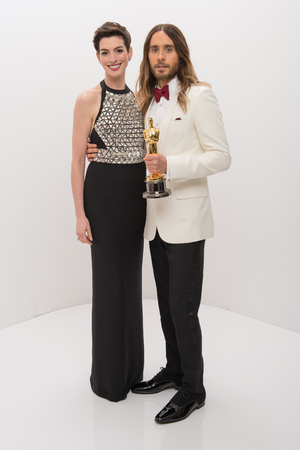 "A.M.P.A.S. After winning the category Performance by an Actor in a Supporting Role for his work in ""Dallas Buyers Club,"" actor Jared Leto poses backstage with his Oscar® and presenter Anne Hathaway 86th Annual Academy Awards Oscars, Portraits, Los Angeles, America - 02 Mar 2014"