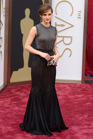 Emma Watson arrives at the 86th Academy Awards.