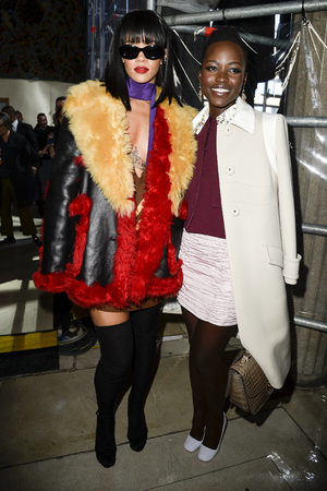 PARIS, FRANCE - MARCH 05: Singer Rihanna and actress Lupita Nyong'o attend the Miu Miu show as part of the Paris Fashion Week Womenswear Fall/Winter 2014-2015 on March 5, 2014 in Paris, France. (Photo by Pascal Le Segretain/Getty Images)