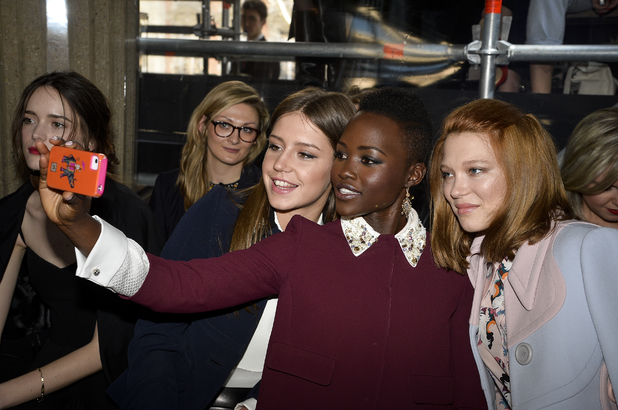 PARIS, FRANCE - MARCH 05: (L-R) Actresses Adele Exarchopoulos, Lupita Nyong'o and Lea Seydoux take a picture as they attend the Miu Miu show as part of the Paris Fashion Week Womenswear Fall/Winter 2014-2015 on March 5, 2014 in Paris, France. (Photo by Pascal Le Segretain/Getty Images)