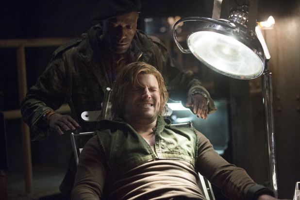 Ronald Selmour as The Butcher and Stephen Amell as Oliver Queen in 'Arrow' S02E15: 'The Promise'