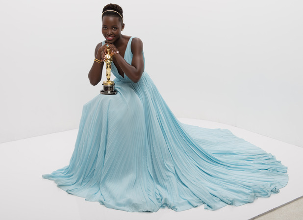 "A.M.P.A.S. After winning the category Performance by an actress in a supporting role for her work in ""12 Years a Slave"", actress Lupita Nyong'o poses backstage with her Oscar® 2 Mar 2014"
