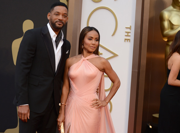 Will Smith, left, and Jada Pinkett Smith arrive at the Oscars on Sunday, March 2, 2014, at the Dolby Theatre in Los Angeles.