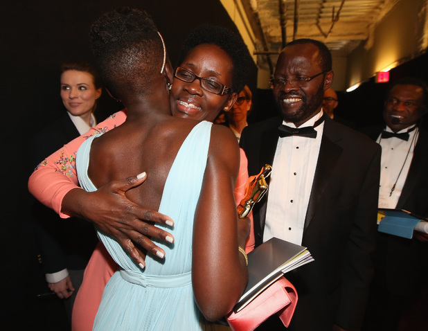 HOLLYWOOD, CA - MARCH 02: Actress Lupita Nyong'o, winner of Best Performance by an Actress in a Supporting Role, with Dorothy Nyong'o (L) and Peter Anyang' Nyong'o backstage during the Oscars held at Dolby Theatre on March 2, 2014 in Hollywood, California. (Photo by Christopher Polk/Getty Images)