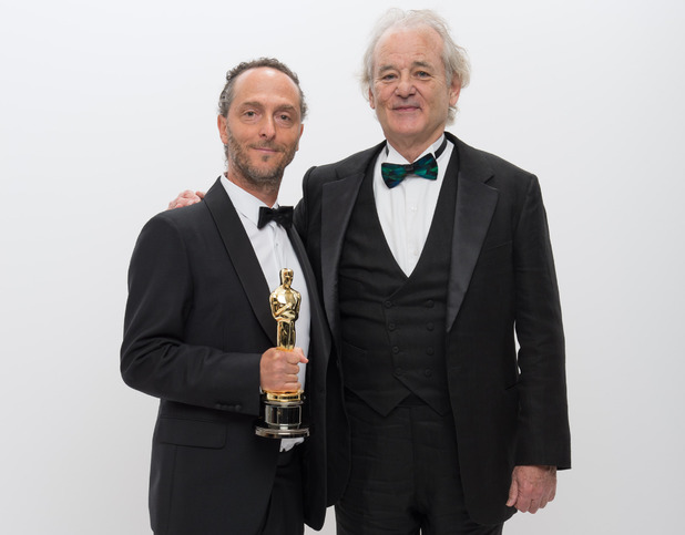"A.M.P.A.S. After winning the category Achievement in cinematography for work done on ""Gravity"", cinematographer Emmanuel Lubezki poses backstage with his Oscar® and Bill Murray 2 Mar 2014"