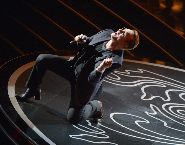 Bono of U2 performs during the Oscars