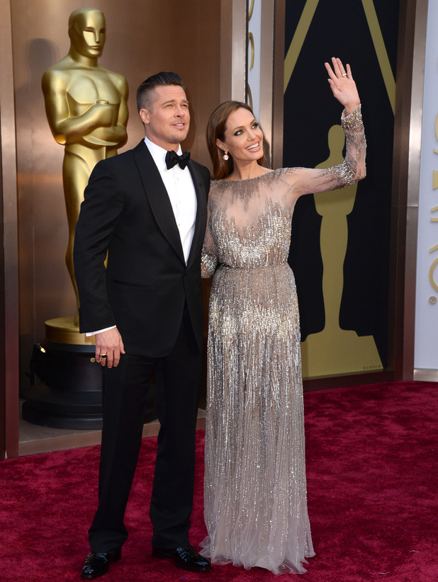 Brad Pitt, left, and Angelina Jolie arrives at the Oscars on Sunday, March 2, 2014, at the Dolby Theatre in Los Angeles.