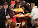 Ellen DeGeneres needed money for pizza after the Oscar host called in a delivery.