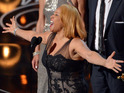 "Darlene Love, center, sings as Janet Friesen, background left, and Morgan Neville accept the award for best documentary feature for '""20 Feet from Stardom' during the Oscars"